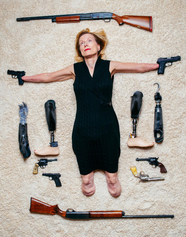 woman poses like Jesus with guns