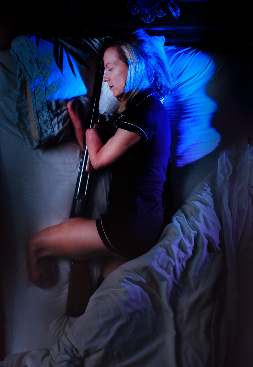 Woman slepping with a rifle